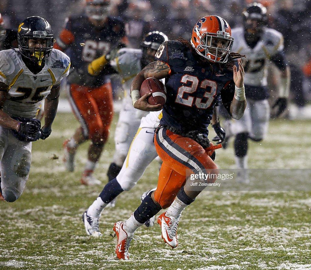 Prince-Tyson Gulley #23 of the Syracuse Orange runs for a touchdown against the West Virginia Mountaineers in the New Era Pinstripe Bowl at Yankee Stadium on December 29, 2012 in the Bronx borough of New York City.