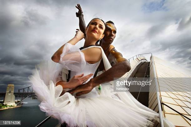 Principal Artist at The Australian Ballet Amber Scott and Bangarra Dance Theatre artist Patrick Thaiday pose during a photo shoot on top of the...