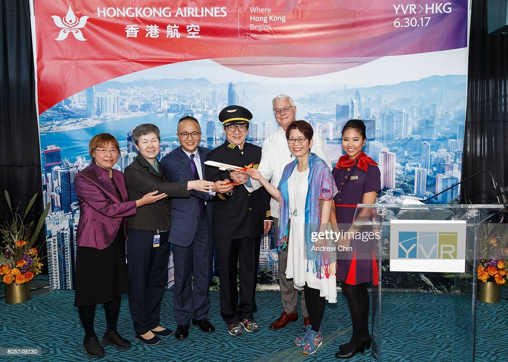 Principal Consultant of Hong Kong Economic and Trade Office Catherine Yuen, Consul General of Consulate-General of China Liu Fei, Chief Marketing Officer of Hong Kong Airlines George Liu, Actor & Martial Artist Jackie Chan, President & CEO of Vancouver Airport Authority Craig Richmond, Minister of International Trade and Asia Pacific Strategy and Multiculturalism Honourable Teresa Wat and a flight attendant pose for a picture during the celebration of Hong Kong Airlines' inaugural flight to Vancouver, BC at Vancouver International Airport on June 30, 2017 in Vancouver, Canada.