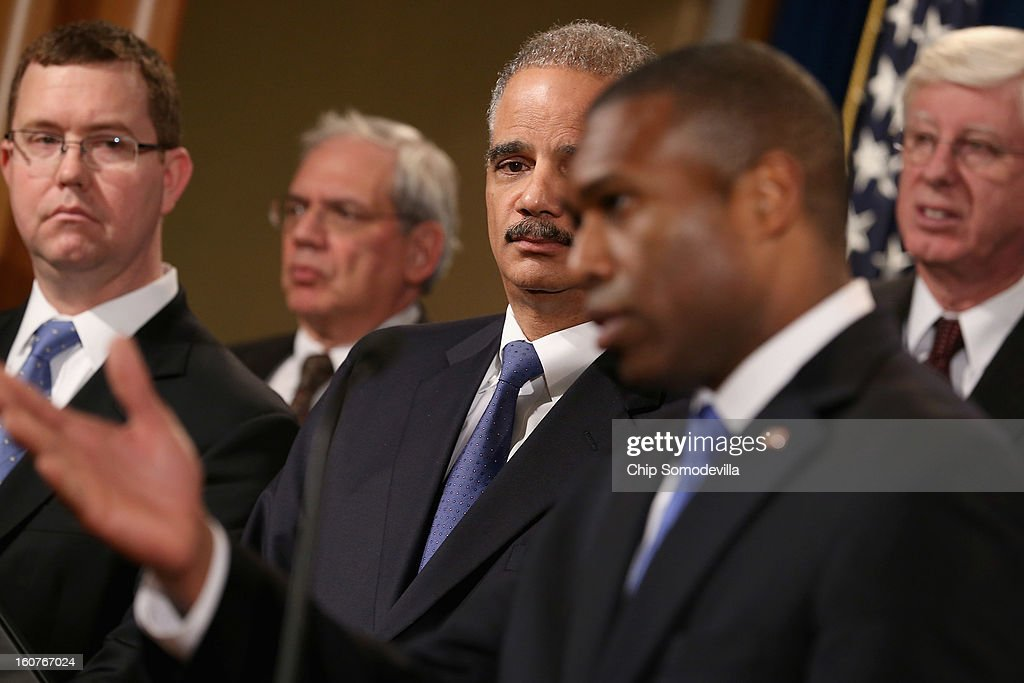Principal Deputy Assistant Attorney General Stuart Delery, District of Columbia Attorney General Irvin Nathan, U.S. Attorney General Eric Holder, Acting Associate Attorney General Tony West and Iowa Attorney General Tom Miller join other state attorneys general for a news conference at the Department of Justice February 5, 2013 in Washington, DC. Holder announced that the United States is bringing a civil lawsuit against the ratings agency Standards & Poor's and its parent company, McGraw-Hill Companies, over its pre-fiscal crisis bond ratings.
