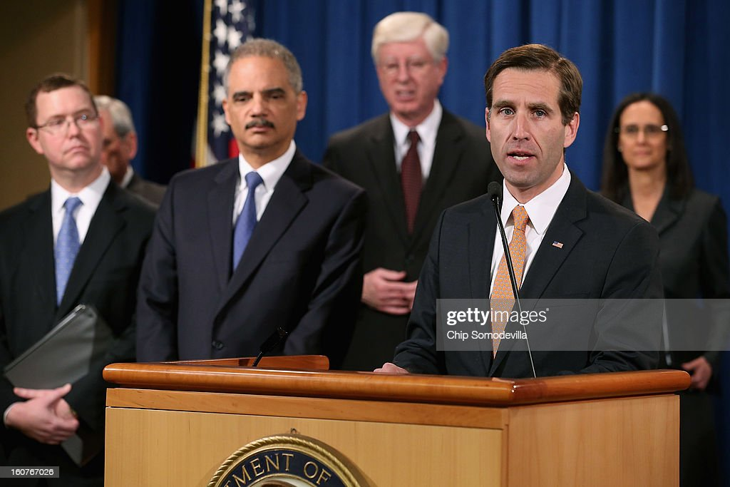 Principal Deputy Assistant Attorney General Stuart Delery, District of Columbia Attorney General Irvin Nathan, U.S. Attorney General <a gi-track='captionPersonalityLinkClicked' href=/galleries/search?phrase=Eric+Holder&family=editorial&specificpeople=1060367 ng-click='$event.stopPropagation()'>Eric Holder</a>, Iowa Attorney General Tom Miller, Deleware Attorney General <a gi-track='captionPersonalityLinkClicked' href=/galleries/search?phrase=Beau+Biden&family=editorial&specificpeople=997123 ng-click='$event.stopPropagation()'>Beau Biden</a> and Illinois Attorney General <a gi-track='captionPersonalityLinkClicked' href=/galleries/search?phrase=Lisa+Madigan&family=editorial&specificpeople=2974155 ng-click='$event.stopPropagation()'>Lisa Madigan</a> hold a news conference at the Department of Justice February 5, 2013 in Washington, DC. Holder announced that the United States is bringing a civil lawsuit against the ratings agency Standards & Poor's and its parent company, McGraw-Hill Companies, over its pre-fiscal crisis bond ratings.