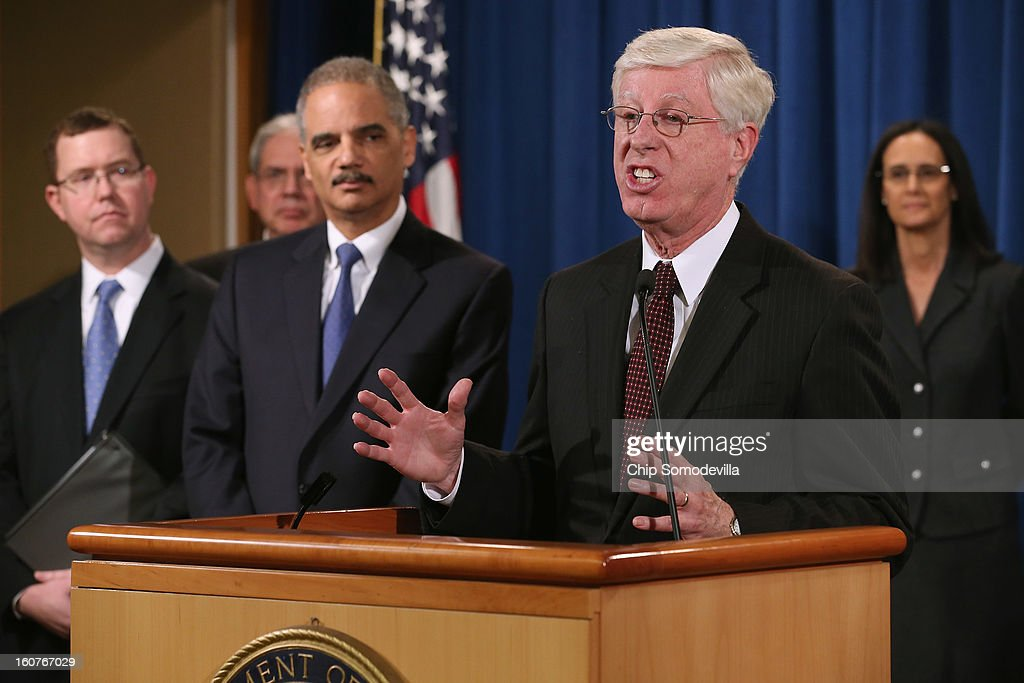 Principal Deputy Assistant Attorney General Stuart Delery, District of Columbia Attorney General Irvin Nathan, U.S. Attorney General <a gi-track='captionPersonalityLinkClicked' href=/galleries/search?phrase=Eric+Holder&family=editorial&specificpeople=1060367 ng-click='$event.stopPropagation()'>Eric Holder</a>, Iowa Attorney General Tom Miller and Illinois Attorney General <a gi-track='captionPersonalityLinkClicked' href=/galleries/search?phrase=Lisa+Madigan&family=editorial&specificpeople=2974155 ng-click='$event.stopPropagation()'>Lisa Madigan</a> hold a news conference at the Department of Justice February 5, 2013 in Washington, DC. Holder announced that the United States is bringing a civil lawsuit against the ratings agency Standards & Poor's and its parent company, McGraw-Hill Companies, over its pre-fiscal crisis bond ratings.