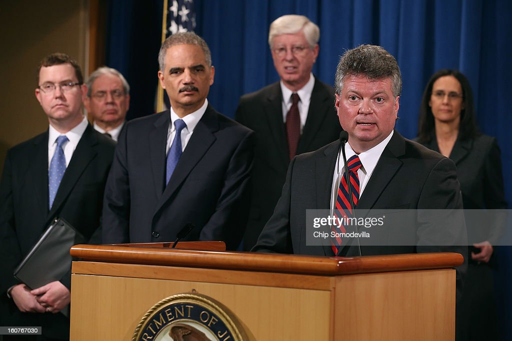 Principal Deputy Assistant Attorney General Stuart Delery, District of Columbia Attorney General Irvin Nathan, U.S. Attorney General <a gi-track='captionPersonalityLinkClicked' href=/galleries/search?phrase=Eric+Holder&family=editorial&specificpeople=1060367 ng-click='$event.stopPropagation()'>Eric Holder</a>, Iowa Attorney General Tom Miller, Mississippi Attorney General <a gi-track='captionPersonalityLinkClicked' href=/galleries/search?phrase=James+Hood&family=editorial&specificpeople=2022577 ng-click='$event.stopPropagation()'>James Hood</a> and Illinois Attorney General <a gi-track='captionPersonalityLinkClicked' href=/galleries/search?phrase=Lisa+Madigan&family=editorial&specificpeople=2974155 ng-click='$event.stopPropagation()'>Lisa Madigan</a> hold a news conference at the Department of Justice February 5, 2013 in Washington, DC. Holder announced that the United States is bringing a civil lawsuit against the ratings agency Standards & Poor's and its parent company, McGraw-Hill Companies, over its pre-fiscal crisis bond ratings.