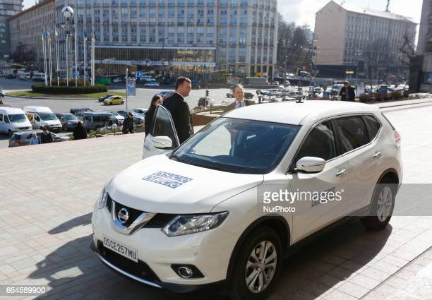 Principal Deputy Chief Monitor of the OSCE Special Monitoring Mission to Ukraine Alexander Hug is seen standing near the OSCE SUV downtown Kyiv...