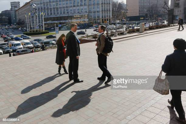 Principal Deputy Chief Monitor of the OSCE Special Monitoring Mission to Ukraine Alexander Hug is seen standing with his OSCE coulleges downtown Kyiv...