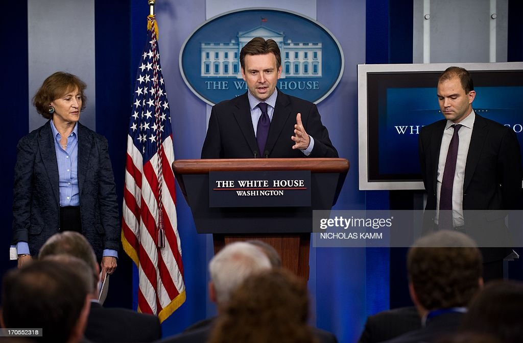 Principal Deputy Press Secretary Josh Earnest (C), Deputy National Security Advisor for Strategic Communications Ben Rhodes (R) and Special Assistant to the President for International Economic Affairs Caroline Atkinson (L) appear at the daily press briefing at the White House in Washington on June 14, 2013. AFP PHOTO/Nicholas KAMM