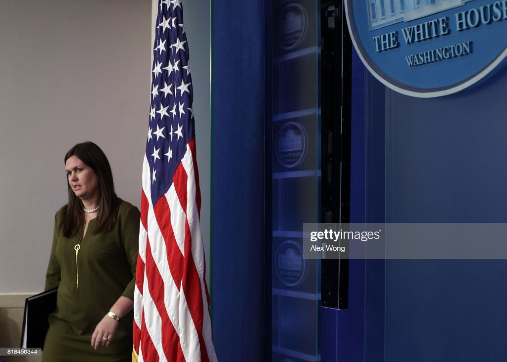 Principal Deputy Press Secretary Sarah Huckabee Sanders walks towards the podium to conduct an off-camera press briefing at the James Brady Press Briefing Room of the White House July 18, 2017 in Washington, DC. Sanders held the press briefing to answer questions from members of the White House press corps.