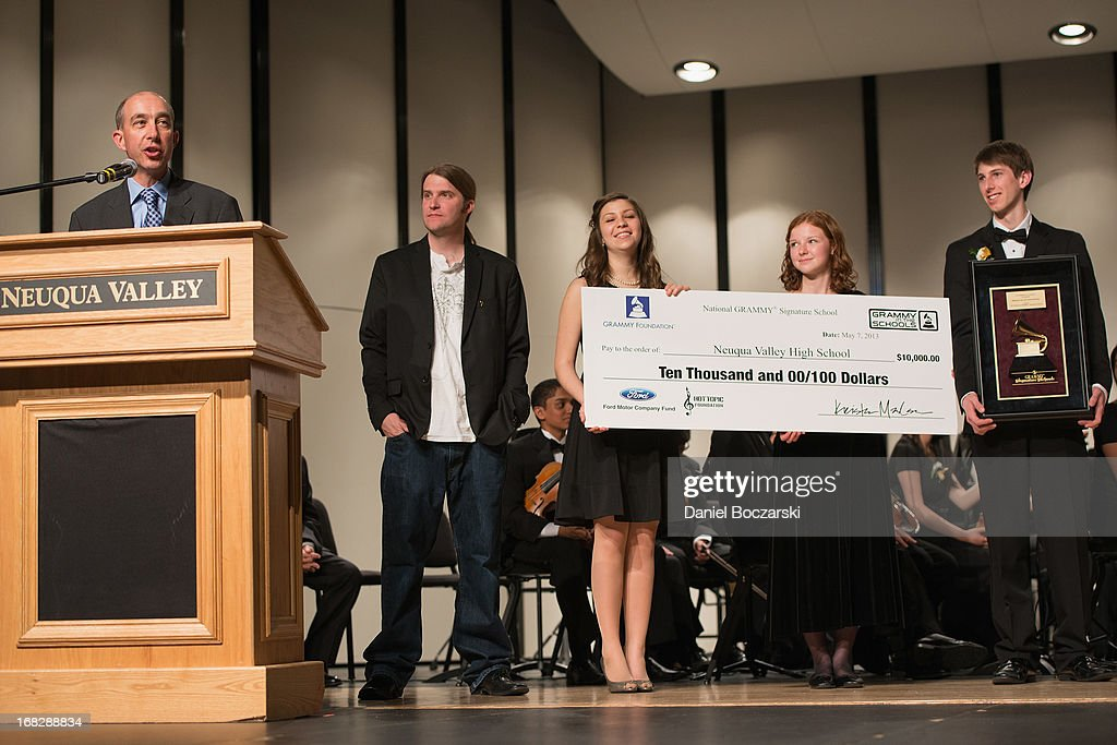 Principal Dr. Robert McBride, President of the Chicago chapter of the Recording Academy Matt Hennessy, and students Caroline Brown, Mary Beth McMullan and Corey Worley attend the GRAMMY Signature School Presentation. Neuqua Valley High School was honored as a National GRAMMY Signature School and received an award of $10,000 at Neuqua Valley High School on May 7, 2013 in Naperville, Illinois.
