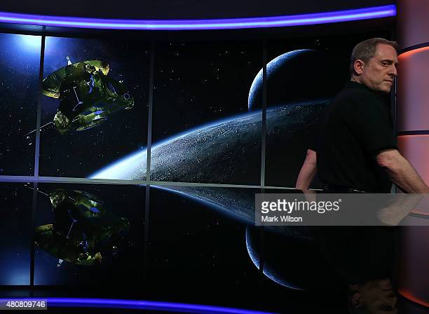 Principal Investigator Alan Stern arrives to discuss the latest image from the New Horizons spacecraft that passed with 7800 miles of Pluto yesterday...