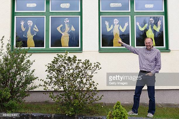 Principal Josef Steinberger poses in front of the Volksschule on May 14 2014 in Bad Mitterndorf Austria Bad Mitterndorf is the hometown of Conchita...