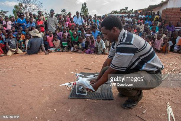 Principal Licencing Officer at the Department of Civil Aviation Birthwell Mbirintengerenji prepares a drone for an awareness and safety demonstration...