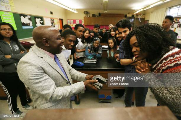 TORONTO ON APRIL 11 Principal Monday Gala enjoys coteaching here he demonstrates an experiment in a The electron charge/mass measuring apparatus to a...