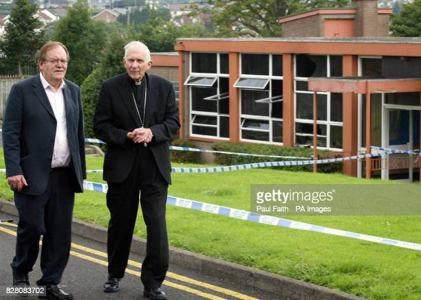 Principal of St Louis Primary School Liam Corey walks with Catholic Bishop of Down and Conor Patrick Walsh outside the school in Ballymena Co Antrim...