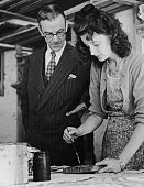 Principal P H Jowett from the Royal College of Art watching a student painting at a studio in Ambleside Lake Windermere Cumbria 3rd July 1943...