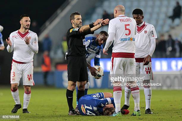 Principal referee Sebastien Desiage reacts after a fault against Bastia's Algerian midfielder Mehdi Mostefa during the French L1 football match...