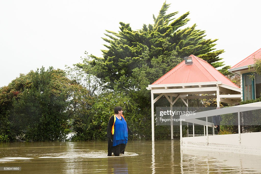 Principal Vanessa Hendry of Porirua School walks through flood water after heavy rain caused flooding on May 5, 2016 in Porirua, New Zealand. Severe rain warnings have been issued for the bottom of the North Island, and and several schools and parts of the city have been closed due to surface floosing