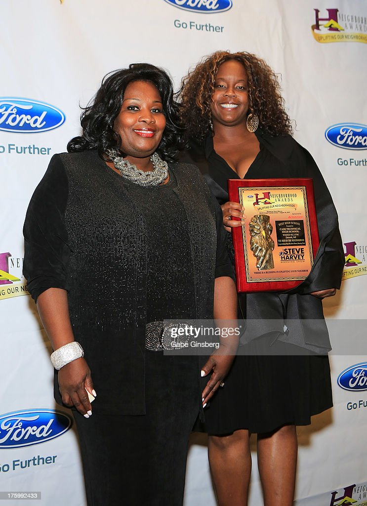 Principle Lisa Phillips (L) and president of the alumni association Ada Nicole Smith receive the award for Best High School for Cass Technical High School in Detroit, Michigan at the 11th annual Ford Neighborhood Awards at the MGM Grand Garden Arena on August 10, 2013 in Las Vegas, Nevada.