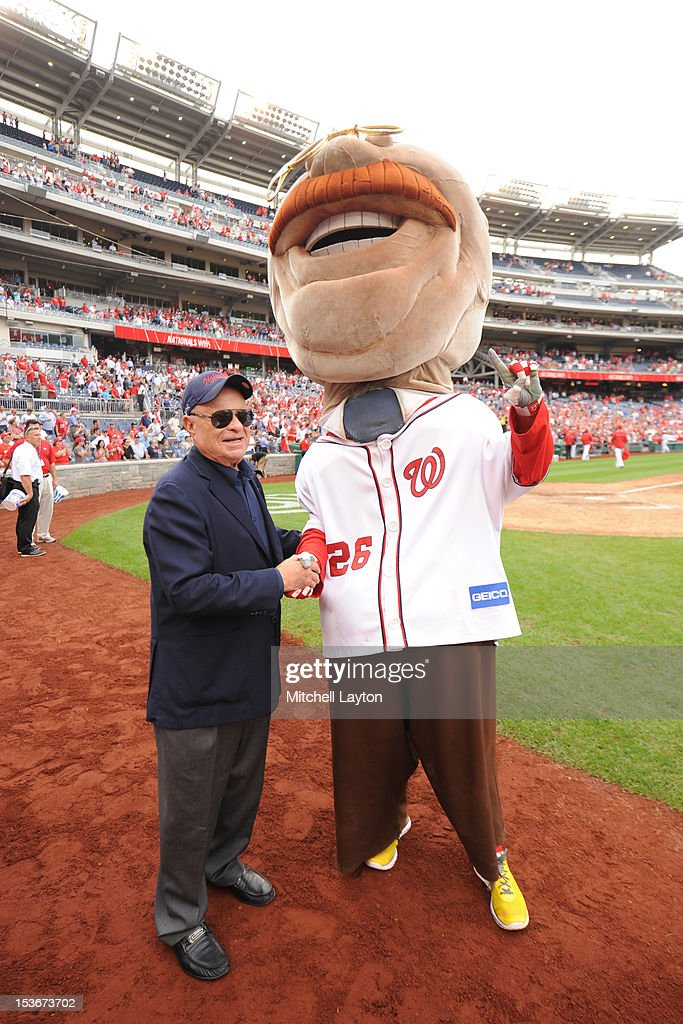 Principle owner Ted Lerner of the Washington Nationals poses for photo with mascot Teddy Roosevelt after a baseball game against the Philadelphia Phillies on October 3, 2012 at Nationals Park in Washington, DC. The Nationals won 5-1.