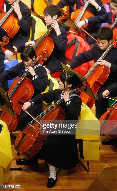 Priness Aiko plays the cello during the All Gakushuin University Orchestra Concert at Gakushuin University on April 13 2014 in Tokyo Japan