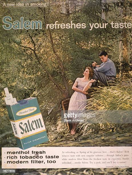 A 1958 print ad for Salem cigarettes showing a couple smoking in the woods and featuring the slogan 'Salem refreshes your taste'