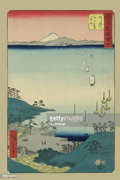 Print shows a bird'seye view of a coastal village with ships in the harbor and a view of Mount Fuji in the distance From the series Gojusantsugi...