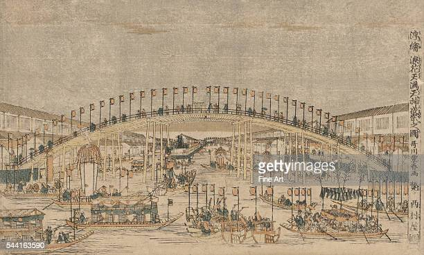 Print shows a festival in honor of Sugawara Michizane taking place at night at the Tenman Tenjin shrine in Osaka