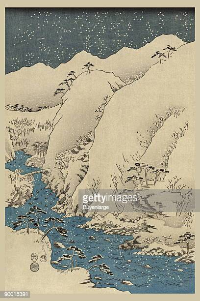 Print shows mountains and river along the Kiso Road during a winter snow storm Part 1 of a tryptich by Ando Hiroshige started in 1857
