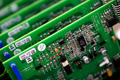 Printed circuit boards sit in racking at Texcel Technology Plc's factory in Dartford UK on Tuesday July 2015 UK economic growth accelerated in the...