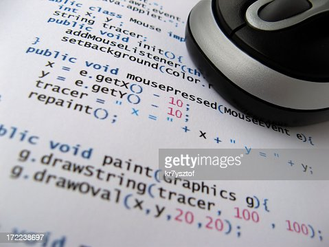 A printed java code under a mouse