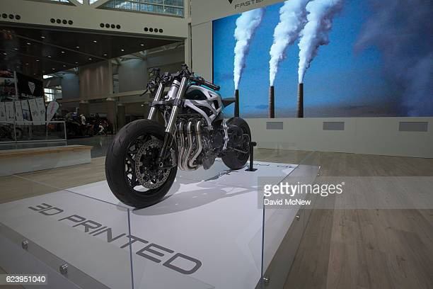A 3D printed motorcycle made by Divergent 3D which is claimed to be a more environmentally friendly and cost effective way to build cars is displayed...