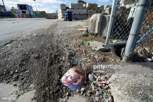 A printed paper cutout of a female face lays on the ground at the gate of the Materials Recovery Facility in South Philadelphia PA on February 13th...