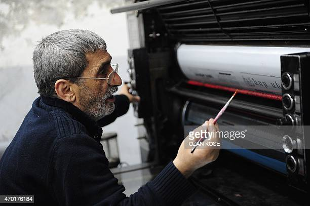 ALFROY A printer inks the rollers at the printing house of Armenian newspaper Jamanak in Istanbul on April 10 2015 Jamanak is the longest...