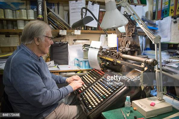 Printer Stan Lane sits at a pneumatic Monotype keyboard as he works on a limited edition letterpress version of a special Ian Fleming Issue of The...