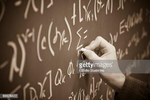 Printing math equations on a chalkboard : Stock Photo