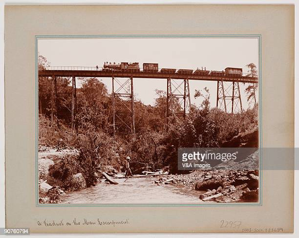 Printing out paper print Photograph by William D Young of a steam train on the Uganda railway which was built during the period of British control of...