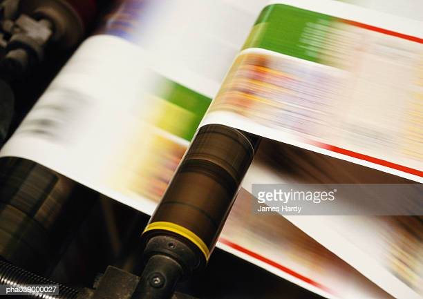 Printing press, close up, blurred motion