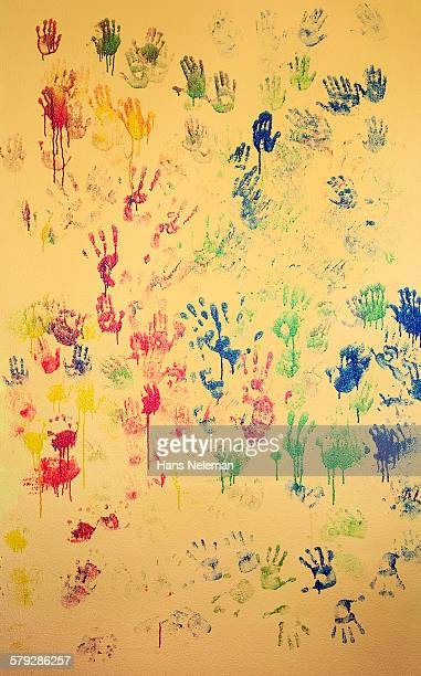 Prints of kids hands on the wall