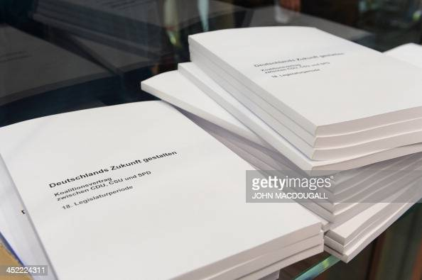 Prints of the agreement to form a coalition government to be signed by Christian Democratic Party Bavarian allies Christian Social Union and Social...
