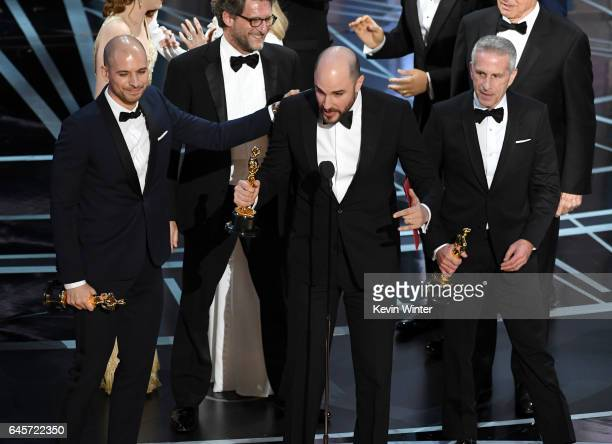 Prior to learning of a presentation error 'La La Land' producers Fred Berger Jordan Horowitz and Marc Platt accept the Best Picture award for 'La La...