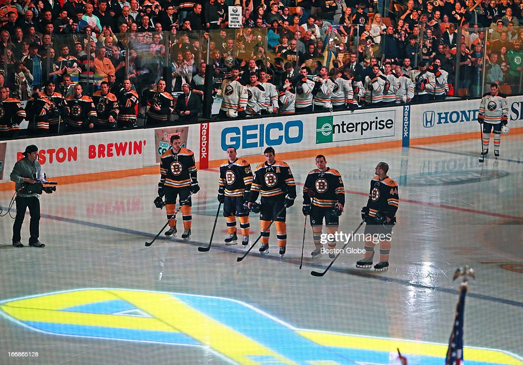 Prior to the game, a moment of silence was held in memory of the victims of the Boston Marathon bombings. The Boston Bruins hosted the Buffalo Sabres in a regular season NHL game at TD Garden. (Jim Davis/Globe Staff) section:sports topic: Bruins-Sabres
