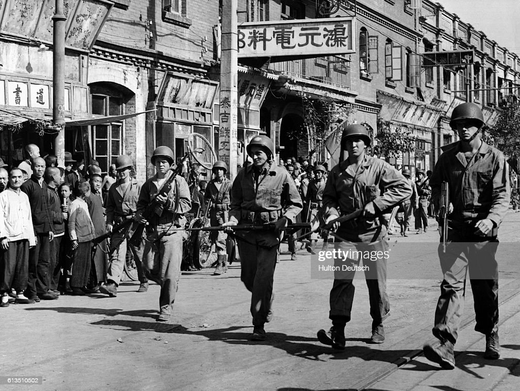 Prior to their departure from china american marines clear tientsin s streets of chinese civilians in
