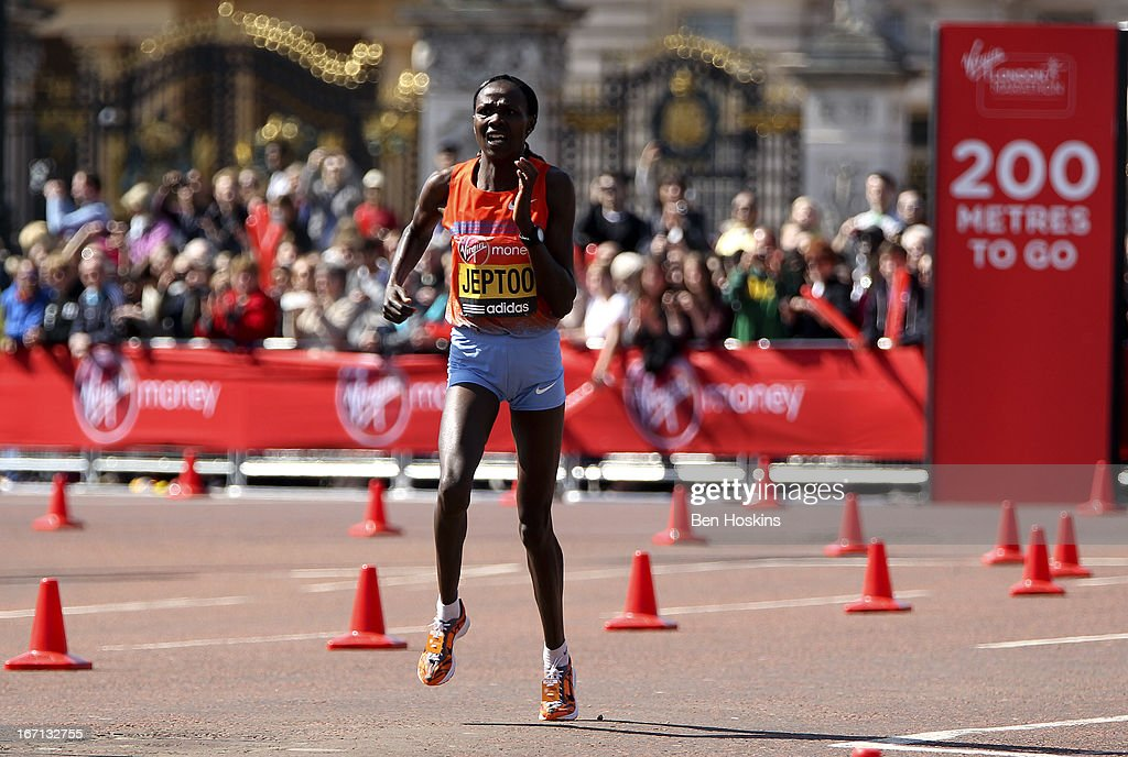 <a gi-track='captionPersonalityLinkClicked' href=/galleries/search?phrase=Priscah+Jeptoo&family=editorial&specificpeople=7640677 ng-click='$event.stopPropagation()'>Priscah Jeptoo</a> of Kenya runs down The Mall towards the finish line and winning the Women's Elite race at the Virgin London Marathon 2013 on April 21, 2013 in London, England.