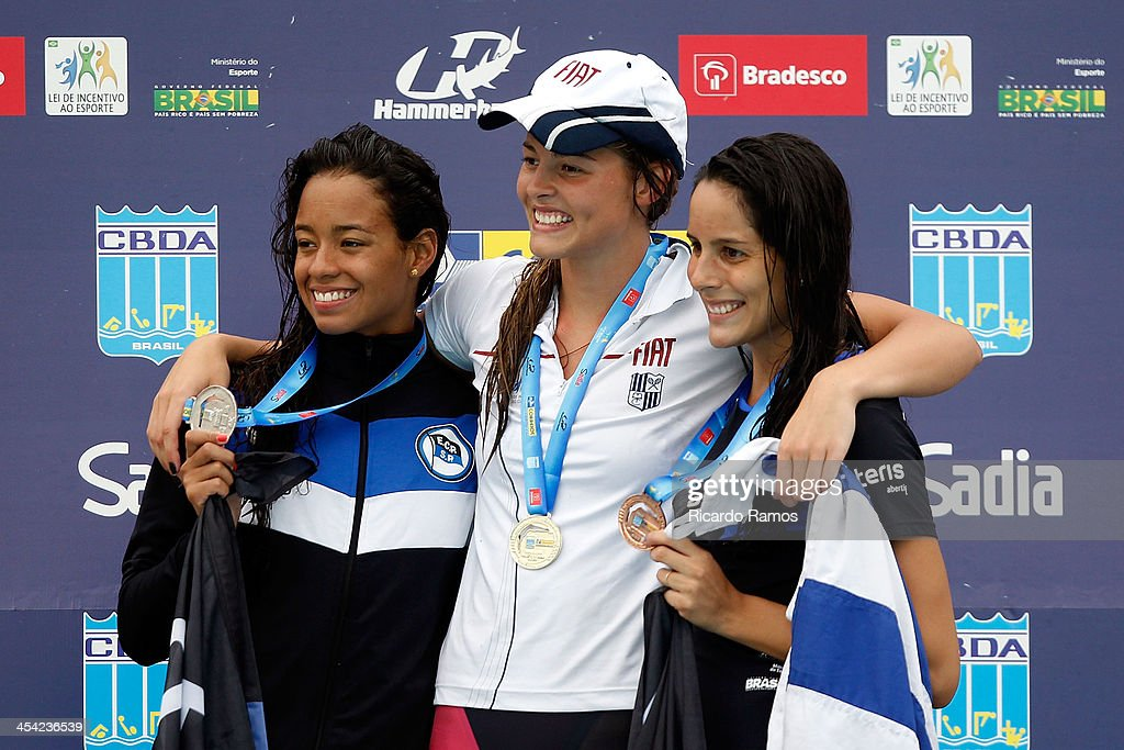 Priscila de Souza, Carolina Bergamaschi and Paula Jardim Escamilla stands on the podium for girls 50m freestyle Junior 2 during Julio Delamare Trophy at Botafogo Aquatic Park on December 07, 2013 in Rio de Janeiro, Brazil.