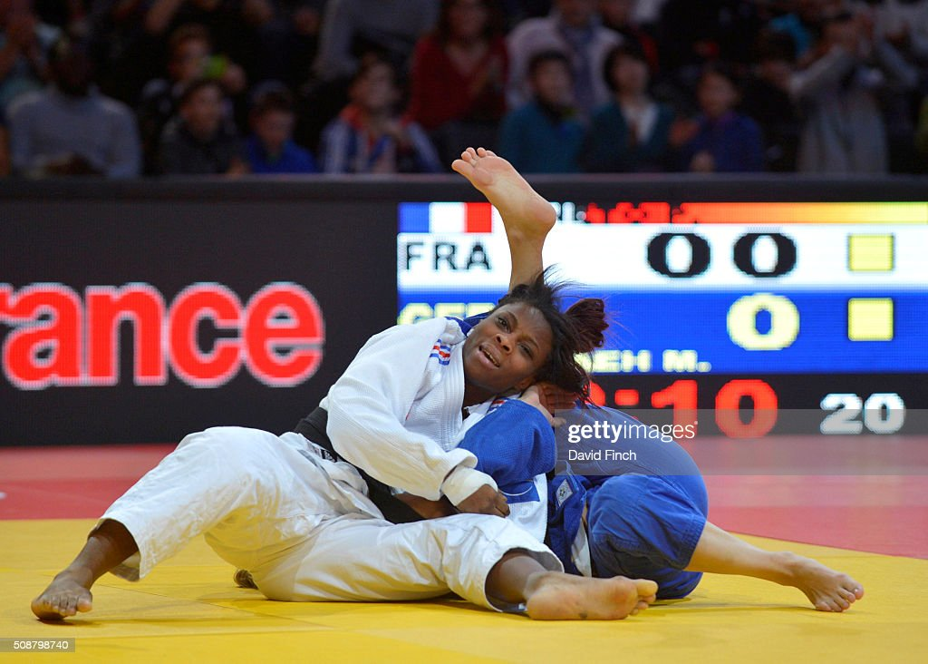 Priscilla Gneto of France holds Mareen Kraeh of Germany for an ippon to win the u52kg bronze medal during the 2016 Paris Judo Grand Slam on February...