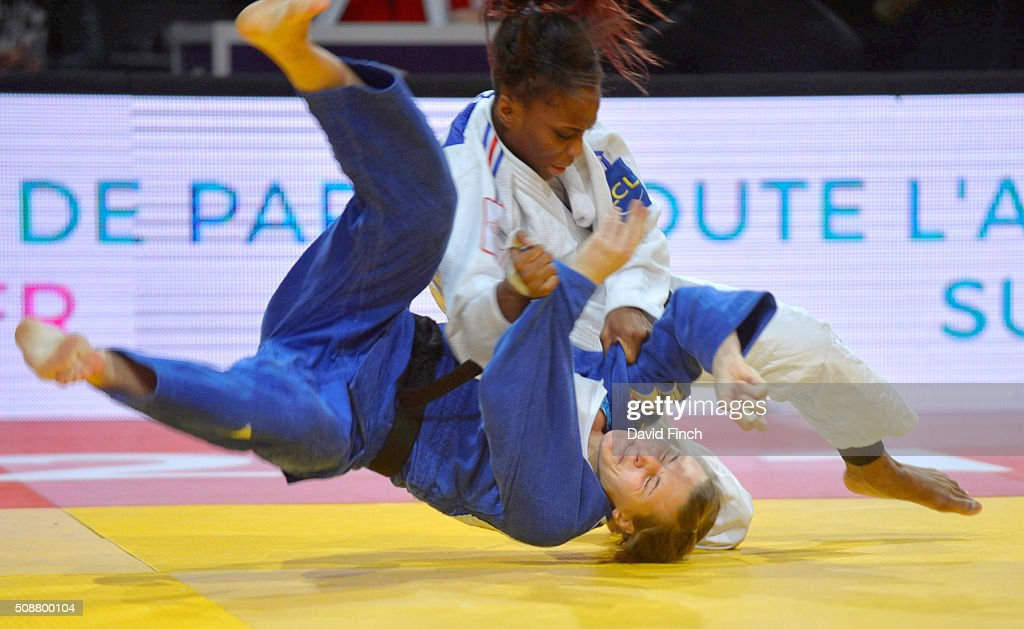 Priscilla Gneto of France throws Maria Ertel of Germany for a yuko to win their match on her way to the u52kg bronze medal during the 2016 Paris Judo...