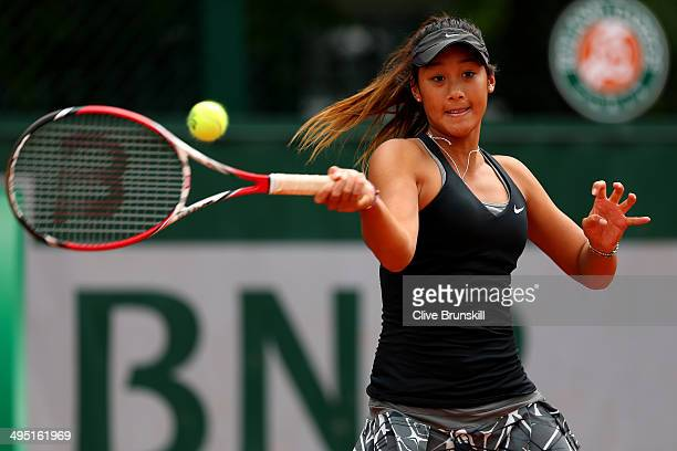 Priscilla Hon of Australia in action in her girls's singles match against Ioana Loredana Rosca of Romania on day eight of the French Open at Roland...