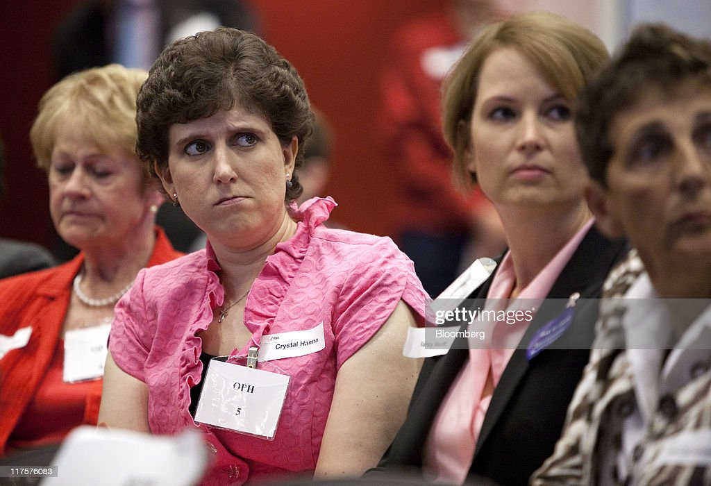 Priscilla Howard, from left, Crystal Hanna, and Nancy Haunty, all breast cancer patients, listen to testimony during a Food and Drug Administration (FDA) hearing in Silver Spring, Maryland, U.S., on Tuesday, June 28, 2011. Breast-cancer patients and their families urged U.S. regulators to back down from a plan to withdraw approval for Roche Holding AG's Avastin, saying the treatment offered significant benefits for some women. Photographer: Joshua Roberts/Bloomberg via Getty Images