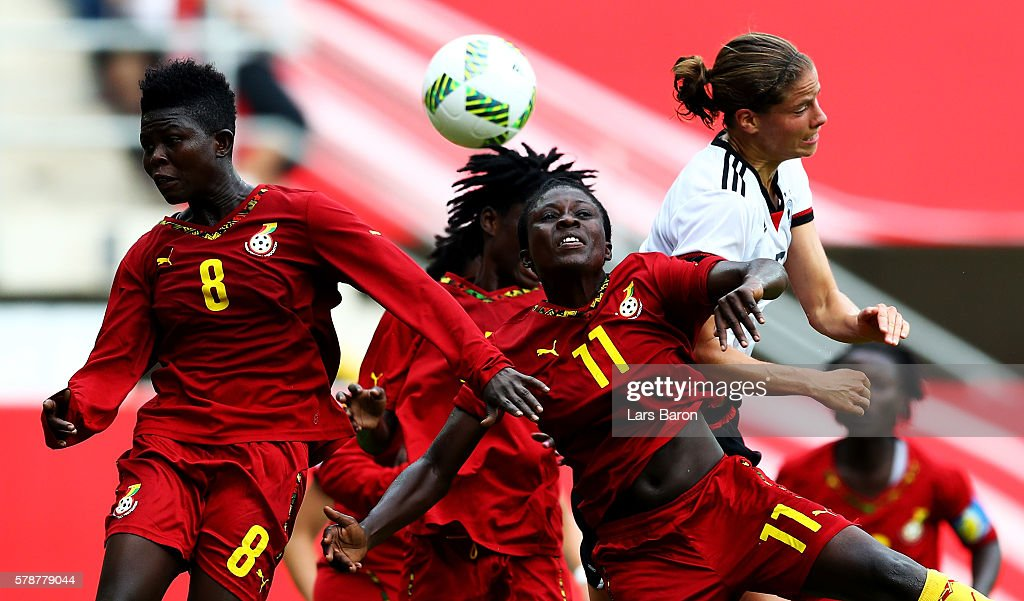 Priscilla Okyere of Ghana and Cynthia Abobea of Ghana go up for a header with Annike Krahn of Germany during the women's international friendly match...