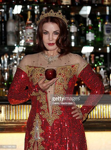 Priscilla Presley attends a photocall ahead of her appearance in 'Snow White And The Seven Dwarfs' at The Savoy Hotel on September 26 2012 in London...