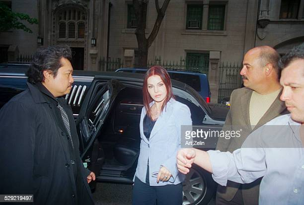 Priscilla Presley getting out of a limousine with security and driver circa 1990 New York